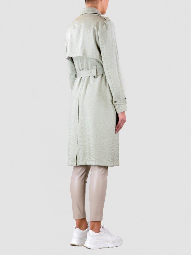 model wearing long trench coat