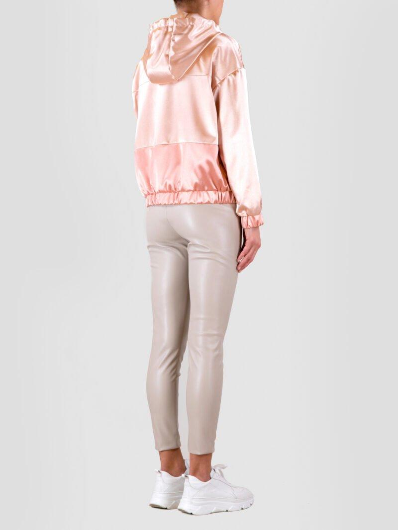 model wearing pink hooded jacket
